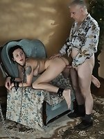 Lovely brunette is chained to chair,...