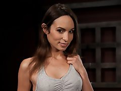 Amber Rayne is chained in a...